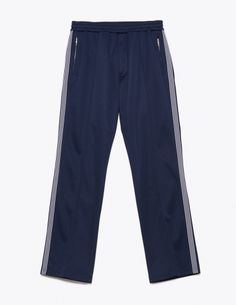 "Trousers from <a href=""http://tres-bien.com/tres-bien/"" class=""uniquelink"">Très Bien</a>. Zip fly. Elasticated waist with drawstrings. Two zipped front pockets. One jetted back pocket. Striped textile ribbon on the sides. Straight legs with pleats on the front and back."
