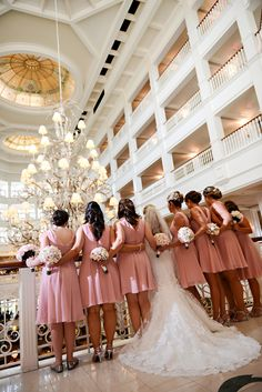 We absolutely adore these timeless and classic light pink bridesmaids dresses at Disney's Grand Floridian Resort & Spa