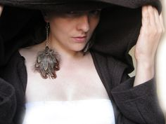 Eccentric Feather Assimetric Earrings Extra long by myParadeShop, $25.00 #jewelry #681team http://www.etsy.com/treasury/NzMxNDk2MHwyNzIzMjg3NTE0/it-was-a-dark-and-stormy-night?index=0