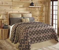 Make a statement in your bedroom by using our Jefferson Star chenille bedding as the main focal point. The black and brown barn stars the the feature print in this quilted bedding ensemble. https://www.primitivestarquiltshop.com/collections/jefferson-star-bedding #primitivecountrybedroombeddingandaccessories