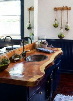 Beautiful furniture piece used as a vanity with an amazing raw edge wood vanity top.