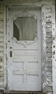 Nice old door. Someone's already removed the door knob though, i see...