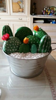 Cactus painted rocks in a tub... Cute maintainable free plants!!