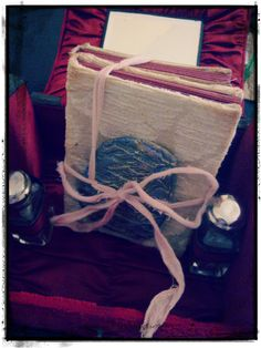 Handmade damask covered mini books with clay seal