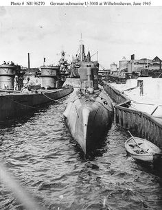 Type XXI submarine, at Wilhelmshaven, Germany, between 2 and 21 June The two Type IX submarines with her are (far left) and The light cruiser Nurnberg is in the far left center. Portsmouth, Submarine Pictures, German Submarines, Electric Boat, Ww2 Pictures, Key West Florida, Navy Ships, Aircraft Carrier, Model Ships