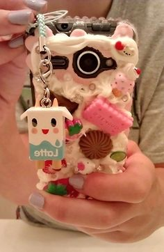 Super cute decoden case! [it looks like this iphone got drunk, covered itself in glue and rolled around hobby lobby]