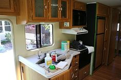 Primed and painted walls - right over the wallpaper - and window casings (this site has lots of good RV remodel info)