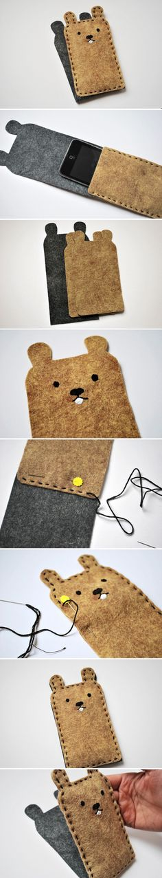Hand-made wool felt cell phone set! I could see Angela DeB making these with a dolmo design! Cute.