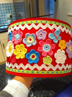 Just Brightening up a plain lampshade and using up all those practice flowers! Great in a little girls room, just glue them on, making sure you use a glue that dries clear......By kerry Warren