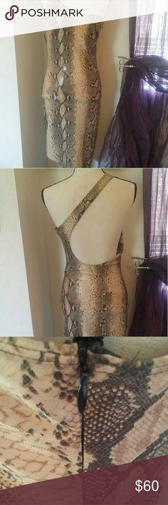 💎Bebe: Pre-loved Diamond Find! Bebe one-shoulder asymmetrical dress.  Faux Leather in a snake print is the definition of sensual elegance. Worn once or twice. 📌Hidden zipper 📌M size 📌Cross-back strap bebe Dresses Asymmetrical