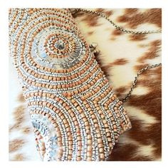 WHBM Beaded Clutch Wood beads and matte silver sequins dance across this boho glam clutch.  So perfect for a beachy bride.  Optional chain can be tucked inside...a girl needs options, no? White House Black Market Bags