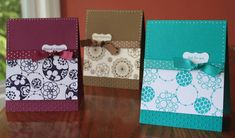 handmade notecard set: Circle Circus Trio by Kristin Moore ... beautifully crafted ... clean design ... stamping and embossing folder texture with a ribbon and a sentiment tag ... Stampin' Up!