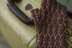 """Fun knit! <span class=""""best-highlight"""">Did the purl stitches in the brown and the knit stitches in the</span> red. Did a 2x2 rib for the thumb (in order to not have giant floats!) This used 28g of the..."""