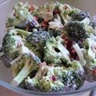 Yummy broccoli salad with bacon, raisins or grapes & sunflower seeds.  Sweet, tangy, I can eat the whole bowl.