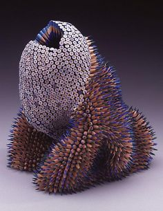 Jennifer Maestre. Pencil, pencil sculpture, pencil art, colored pencils, repetition, repetitive art, pencil creature, spikes, spiky, blue.