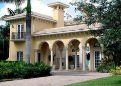 Love the arches of this house, as well as the balcony