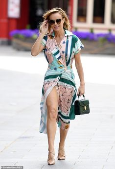 Giggling: Amanda Holden narrowly avoided a wardrobe mishap on Tuesday when a gust of wind blew her wrap dress open outside the Heart Radio studios 70s Fashion, Women's Fashion Dresses, Womens Fashion, Sexy Older Women, Sexy Women, Beautiful Women Over 40, Beautiful Celebrities, Britain's Got Talent, Amanda Holden