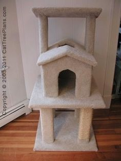 Kitty Tree House Plans with two peek a boo holes and top V shaped lounging perch for your lazy kitty.