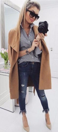 stripped shirt + camel coat and rips fall street style