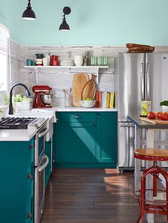 We customized these Ikea units with doors and drawer fronts by Semihandmade, which specializes in upgrades for the Swedish superstore's basic systems.  Cabinet color BM Oasis Blue  Read more: Beach House Living Room - 2013 House of the Year  Follow us: @Country Living Magazine on Twitter | CountryLiving on Facebook  Visit us at CountryLiving.com