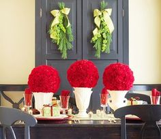"""Love this red and white topiary arrangement! (from """"Chic Centerpieces to Fill Your Table with Holiday Cheer"""") #Christmas #table #decorating #ideas #contemporary"""