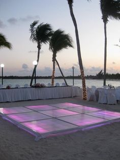 The dancefloor/ where you'd cut the cake. And we would add some orange and red flowers around there too