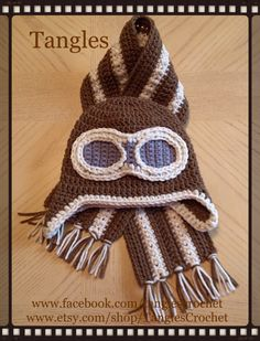 Baby aviator hat and marching scarf crocheted by Tangles. *Pattern for hat: Repeat Crafter Me *Pattern for scarf: Tangles