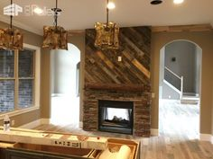 #Fireplace, #HomeDécor, #LivingRoom, #PalletFireplace, #PalletFireplaceSurround, #PalletMantle, #PalletWall Dress up that tiredold fireplace and turn it into this Stellar Pallet Fireplace Surround! Make a project that could be one-of-a-kind for around 100 dollars! I salvaged these pallets from work in our yard. They had been getting weathered for years,