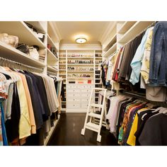 closets - walk-in closet glossy wood floors built-ins shelves drawers shoe shelves Melanie Fascitelli Gorgeous walk-in closet with glossy coffee