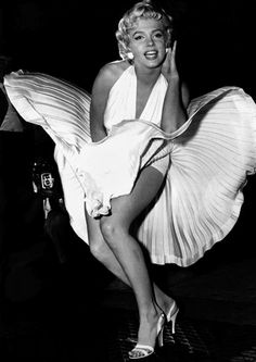 September 9, 1954. During a publicity shot for The Seven Year Itch, Marilyn Monroe stepped onto a New York subway grille. Like that of Botticelli's Venus rising from the ocean, Marilyn's pose is both virginal and seductive. The undulating skirt, floating around the figure, emphasizes the dual seduction of movie star and spectator: Marilyn is seduced by the camera, and in the same moment, the photographer and spectators are seduced by her beauty.