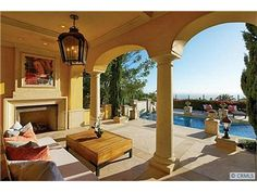 Panoramic views from the home and stunning resort-like yard with covered loggia, sparkling pool and spa include the ocean, Newport Harbor, Catalina and coastal and city lights