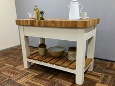 Freestanding Kitchen Island fitted with an 80mm thick butcher's block oak worktop. Features a useful full width drawer mounted on soft close runners & a slatted oak lower storage shelf. Shown here finished in Little Greene 'Clay Mid' but be hand painted in any other colour. Size shown is W:1200mm H:910mm D:620mm & paint colour is Little Greene Clay Mid. Free Standing, Shelves, Freestanding Kitchen Island, Workstation, Freestanding Kitchen, Painted Kitchen Island, Kitchen, Storage Shelves, Medium Kitchen
