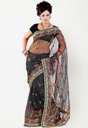 Black coloured saree for women by Rachna. This embellished saree is made from net and comes with unstitched blouse piece.