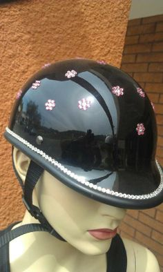 Bling your Lady's Motorcycle Helmet to match your ride. We use Genuine Swarovski Crystals for the best sparkle and shine. Create your own design for your helmet or let us do it for you. Sparkle up your day with Custom Bling by Ricci~  Simple and sweet flowers in the color of your choice with a single shining row of genuine swarovski crystal.  It's sure to sparkle up your day. Starting at $125.00