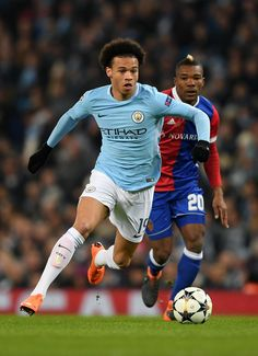 Leroy Sane of Manchester City breaks clear from Geoffroy Serey Die of FC Basel during the UEFA Champions League Round of 16 Second Leg match between Manchester City and FC Basel at Etihad Stadium on March 7, 2018 in Manchester, United Kingdom.