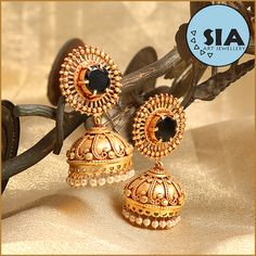 Sia Gheru Gold Polish Earrings. A classical pair of ethnic earrings from SIA STAR SIGNATURE LINE. The pair of earrings has a nice black stone studded and a Jumar at the bottom. The earrings is perfect blend of South & North Indian jewellery.This is a perfect example of ethnic Indian bridal jewellery.