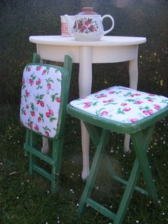Fold-up seats rescued from the dump. Repainted and covered in Cath Kidston strawberries oilcloth
