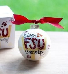 Any fan will cheer for this FSU Gameday Ornament on their Christmas tree. Florida State, Florida State, Woo! Personalize it with a name or whatever you'd like for a unique spirited keepsake. All collegiate specialty glass ornaments come boxed and tied with a coordinating ribbon making them the perfect gift for anyone.