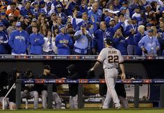 Fans yell as San Francisco Giants pitcher Jake Peavy is taken out of the game during the second inning of Game 6 of baseball's World Series against the Kansas City Royals Tuesday, Oct. 28, 2014, in Kansas City, Mo. (AP Photo/David J. Phillip)