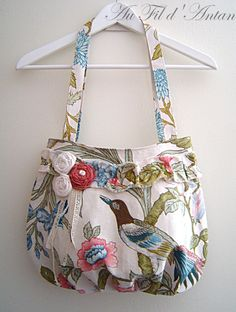 Shabby chic bag ♥ by www.alittlemarket.com.  Love the fabric, pleated details at the bottom center of the bag and those fabric roses