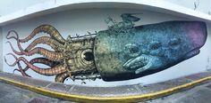 Alexis Diaz es un artista puertorriqueño que hace unos murales llenos de colores que son impresionantes.  Usando un solo pincel este artista arma elefantes, serpientes, cosas de anatomía y hasta plantas, todas llenas de muchísimos colores.