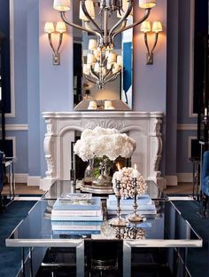 Decor Therapy: an organized home. . . — The Decorista  -  Really like fireplace, mirror, glass elements.