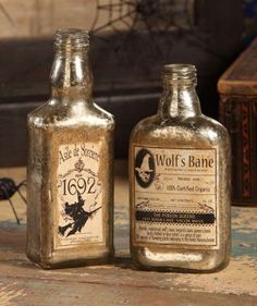 Antique Halloween Bottles (Small) - Bethany Lowe – Black Bow Halloween Shoppe. Keep your potions safe in these beautiful antique bottles. Your Wolf's Bane and Asile de Sorciere can be paired with the Antique Halloween Bottles (Medium) or Antique Halloween Bottles (Large) to create a creepy collection! Sold as a set of 2 bottles. Bethany Lowe. Glass with printed paper labels. 6 1/2″ and 5 3/4″. FREE SHIPPING!!