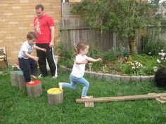 Back yard obstacle course - kay, the obstacle course is cool, but look at those painted stumps.  I need a back yard so that I can make those!