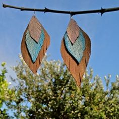 DIY feather leather earrings. An easy tutorial to make a fabulous and stylish pair of leather earrings.