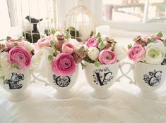 Anthropology mugs used in a creative way...not to mention, beautiful floral arrangements.