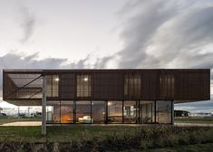 MAPA's XAN #House in Brazil combines raw concrete with slatted timber
