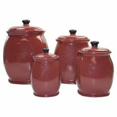"4 earthenware canisters in chili red with black knobs. Product: Small, medium, large and extra large lidded canisterConstruction Material: EarthenwareColor: Chili red and black     Dimensions:   Small: 2.5"" H x 5"" Diameter  Medium: 3"" H x 3"" Diameter  Large: 7"" H x 4"" Diameter  Extra Large: 9"" H x 5"" Diameter"