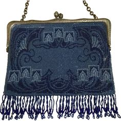 Curvaceous, sinuous, asymmetrical lines are some of the elements of art nouveau design. Such is this delightful microbeaded purse with its depiction