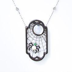 Spiderweb pendant, 1930's-40's, blackened steel, platinum, jade and pearl and moonstone